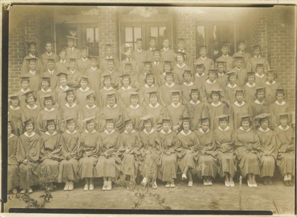 highschool grandma class photo in caps & gowns